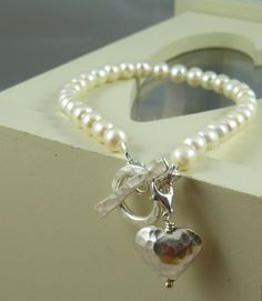Freshwater Pearls with Karen Hill Tribe hammered toggle clasp & heart charm, all other silver used is 925 sterling silver. Made to measure.