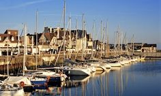 Boats lined up on the quay at Deauville harbour