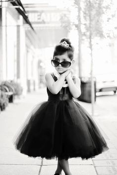 She looks like a mini Audrey Hepburn!