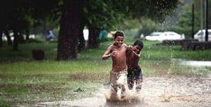 Children out playing in the rains in Kerala