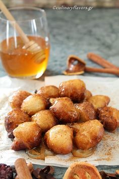 Have you had Loukoumades (Greek Doughnuts) before? I'm drooling just looking at them! They're simple dough balls served warm with cinnamon and honey/syrup.