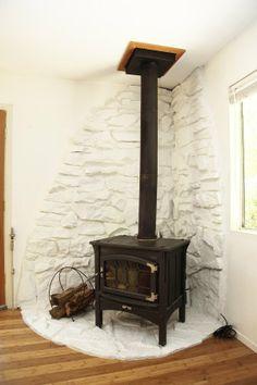 Jon & Tyke's Modern Cabin Wood stove in a modern log cabin Corner Wood Stove, Wood, Stove, Wood Pellet Stoves, Modern Cabin, Pellet Stove, Cabin Homes, Brick And Wood, Wood Stove Hearth