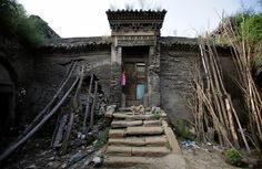 Tree trunks and rocks are set up to support a leaning wall of Li Yonghua's damaged cave house in an area where land is sinking next to a coal mine, in Helin village of Xiaoyi, China's Shanxi province, August 2, 2016. REUTERS/Jason Lee           SEARCH 'SINKING CHINA' FOR THIS STORY. SEARCH 'THE WIDER IMAGE' FOR ALL STORIES. via @AOL_Lifestyle Read more: https://www.aol.com/article/news/2017/07/10/sweden-ranked-best-country-to-be-an-immigrant/23023633/?a_dgi=aolshare_pinterest#fullscreen