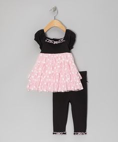 A flutter with hearts and wispy tulle, this set is as sweet and stylish as can be. Snug and stretchy leggings ensure a marvelously mobile fit for a day of play.