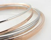 Rose gold and silver bangles - silver and rose gold bracelets - simple rose gold jewelry. $42.00, via Etsy.
