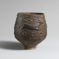 Terracotta cup with barbotine decoration Period: Imperial Date: 2nd–early 3rd century A.D. Culture: Roman Medium: Terracotta Dimensions: H. 3 3/8 in. (8.6 cm)