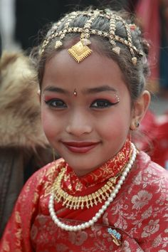 cute asian girl in folklore dress looks like mini Me of JLo ; )
