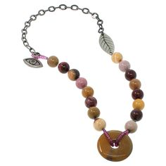 I made a very successful necklace using this technique for stringing a donut bead.