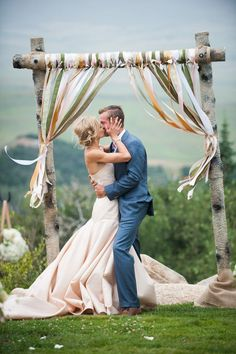 romantic kiss wedding photo before rustic altar