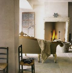 neutral simplicity. I love the minimalism in this interior.  Also love the tall fireplace and limestone floor.  YUM!