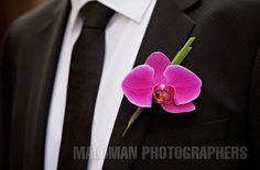 Fuchsia orchid boutonniere #YourMiamiWedding