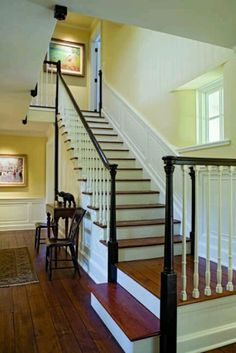 Love the contrast of white spindles, black banisters and wood floors