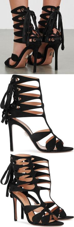 Crafted of black suede, these sandals are styled with cutouts, a lace-up back, and a slim stiletto heel.