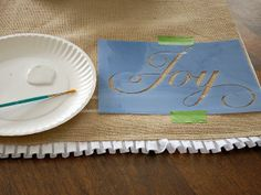 How to Make a Hand-Painted Burlap Table Runner : Page 02 : Decorating : Home & Garden Television Painted Burlap, Painted Letters, Hand Painted, Burlap Christmas, Christmas Crafts, Christmas Ideas, Holiday Ideas, Christmas Decorations, Purple Wedding Tables