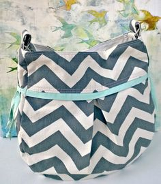 Youll fall in love with this hobo style green chevron purse. Its versatility makes it perfect for everyday use. Its the perfect size for your
