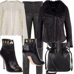 Pantalone in pelle, slim fit, camicia davvero romantica per questo look dall'anima rock, color crema, giacca con zip calda, tronchetto spuntato da indossare con calze nere coprenti di lana, secchiello black,