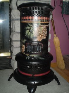 vintage keresene heater painted with pine and plaid. I WANT THIS!!!