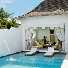 Why We Love It: The large, shallow top step of this pool provides plenty of space for two in-water chaise lounges. These prime spots are the best of both worlds, with dry, comfortable cushions for relaxing as well as instant access to the cool water. A wa