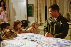 Actor Mel Gibson as Lieutenant Colonel Harold G. Moore, Madeleine Stowe as Julie, Luke Benward as David, Taylor Momsen as Julie and Sloane Momsen as Cecile in the movie We Were Soldiers directed by Randall Wallace