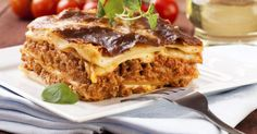 Most lasagna recipes are for a pan serving 8 to 10 people. Lasagna is a bit tricky because of the many layers to warm and the outer cheese might get burnt or coagulate if you aren't careful. For those with small families, making a complete dish of lasagna is cost effective and time efficient, as long as you can reheat the dish without sacrificing...