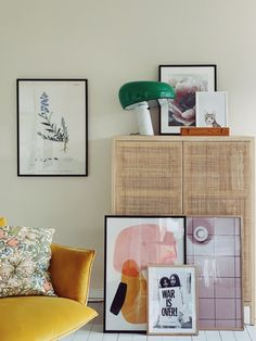 framed art collection leaning against cabinet with woven doors and vintage green snoopy lamp on top. Room Inspiration, Interior Inspiration, Decor Interior Design, Interior Decorating, Bohemian Furniture, Home Decor Bedroom, Sweet Home, Instagram Worthy, Vintage Green