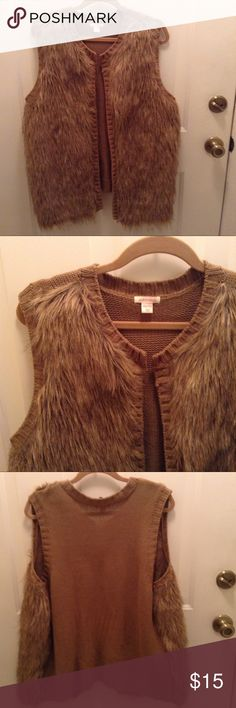 Xhilaration Faux Fur Sweater Vest The picture actually makes it look darker. . It's more a dark beige with tan & black polyester lined fur on the front.  It's lightweight, 29 inches long, and 67% Acrylic/33% Polyester. Xhilaration Sweaters Cardigans