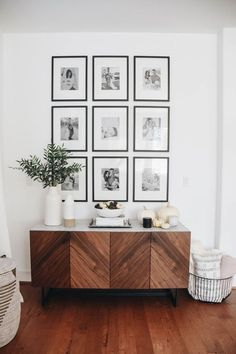 modern farmhouse foyer design with herringbone buffet with grid wall gallery wit. modern farmhouse foyer design with herringbone buffet with grid wall gallery with black and white photos, modern farmhou. Gallery Wall Frames, Frames On Wall, Modern Gallery Wall, Photo Frame Walls, Modern Farmhouse Gallery Wall, Photo Frame Design, Modern Wall, Art Gallery, Boho Living Room