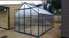 Vitavia Jupiter 11500 14x8. Powder Coated green with Poly Carbonate panels. Installed in Torquay on 30.01.2018.