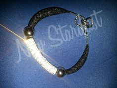 Bracciale tubolare nero argento