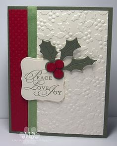 Love the matching holly embossing folder