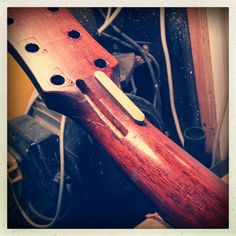Reinforcing a broken guitar neck repair with splines.