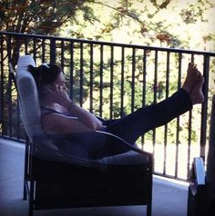 mariska hargitay relaxing on a sunny day on the porch talking on the phone