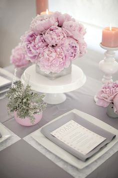 Pink peonies and grey accent pieces make this centerpiece modern and chic! We really enjoy the simplicity of it! Do you? Vendor credit: MMD Events http://mmdevents.com/