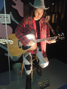 with sitting down with his guitar, Wax Statue, Neil Young, Guitar, Punk, Celebrities, Music, Image, Collection, Design