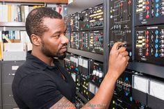 A black man at an electrical panel - Stock Photos & Images | Stockafe.com #stockafe #stockphotos