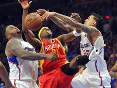 Game 3 in Los Angeles: Clippers 124, Rockets 99 — Houston guard Jason Terry (31) loses control of the ball between Los Angeles defender Glen Davis (0) and Matt Barnes (22).  Gary A. Vasquez, USA TODAY Sports