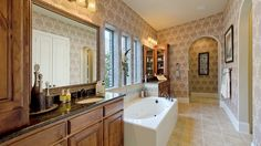 A master #bathroom oasis with large soaking tub and an abundance of #cabinet and counter space by Darling Homes at Star Creek 80s.