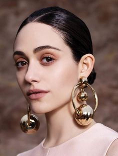 Follow Rent a Stylisthttps://www.pinterest.com/rentastylist/ Sleek bun with large gold earrings