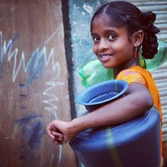 A girl gathers water in Bangalore, India.