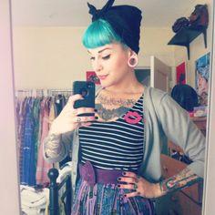 Wearing my hair in rollers all day today #pinup #pinupgirl #pinuphair #pincurls #pastelhair #dyedhair #rockabilly #rockabella #ootd #plugs #girlswithplugs #tattoos #girlswithtattoos #tattooed #tattooedgirls #altgirl #ink #pinuphairstyle #vintage #vintagestyle #vintagehairstyle #1950s #style #babeswithink #bettybangs #bettiebangs #rosietheriveter #bluehair #tealhair