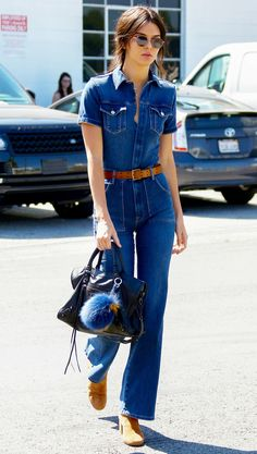 Kendall Jenner was giving us major '70s vibes in this too-chic denim jumpsuit, which she paired with a tan belt, tan boots, and black Balenciaga bag. Shop the look here.