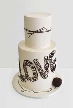"""Brides.com: Beautiful Wedding Cakes for Every Season. """"Tie the Knot"""" Wedding Cake. I've seen some """"tie the knot"""" wedding cakes that feature a nautical theme (with sailor knots!), but this is the first riff on the idea with a more rustic and playful look. Cake designer Faye Cahill in Australia created a simple two-tiered cake covered in fondant, then embellished the tiers with brown icing designed to resemble twine."""