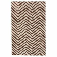 Bring a pop of pattern to your living room or den with this eye-catching wool rug, featuring a contemporary chevron motif in beige.   Product: RugConstruction Material: 100% WoolColor: Beige and brownFeatures: Hand-hookedNote: Please be aware that actual colors may vary from those shown on your screen. Accent rugs may also not show the entire pattern that the corresponding area rugs have.Cleaning and Care: These rugs can be spot treated with a mild detergent and water. Professional ...