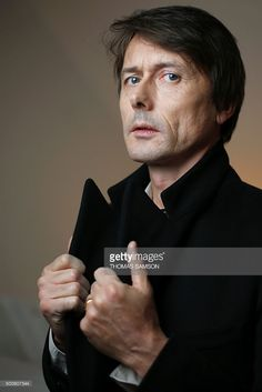 British singer and songwriter, best known as the lead vocalist of the band Suede, Brett Anderson, poses in Paris on December 9, 2015. / AFP / THOMAS