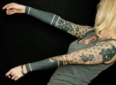 Blackout sleeve tattoos