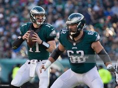 Carson Wentz #11 of the Philadelphia Eagles looks to pass and Jason Kelce #62 blocks against the Dallas Cowboys at Lincoln Financial Field on January 1, 2017 in Philadelphia, Pennsylvania. The Eagles defeated the Cowboys 27-13.