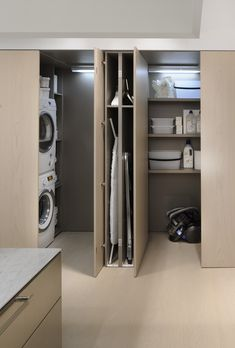 Minimalist Kitchen Design And this long island seamlessly complements that vision. Its length accomm Laundry Room Design, Laundry In Bathroom, Kitchen Design, Laundry Rooms, Laundry Closet, Kitchen Interior, Utility Closet, Laundry Area, Mud Rooms