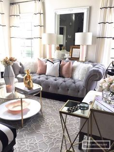 Elegant and Sophisticated Living Room   Grey and White Living Room   Blush Accents   Grey Sofa   Round Glass Coffee Table
