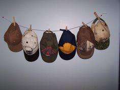 Boys hat storage - thumbtacks, string, and clothespins.
