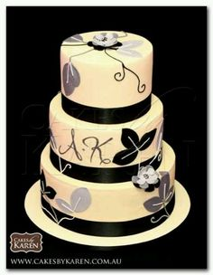 A unique black, gray and ivory wedding cake